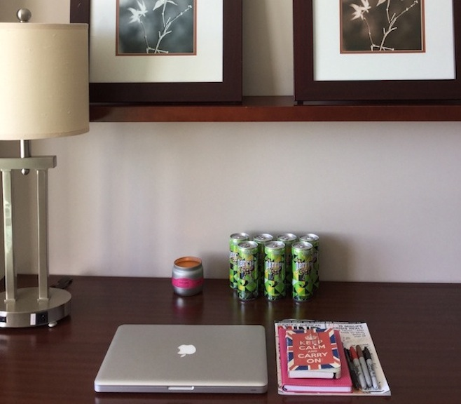4.Hotel Room Desk Perrier water and notebooks